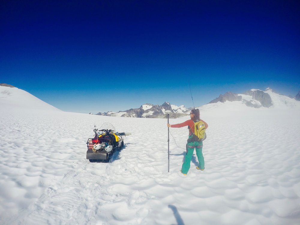 A GPS Survey student collects GPS data on the position of the surface of the glacier. Photo credit: Brittany Ooman.