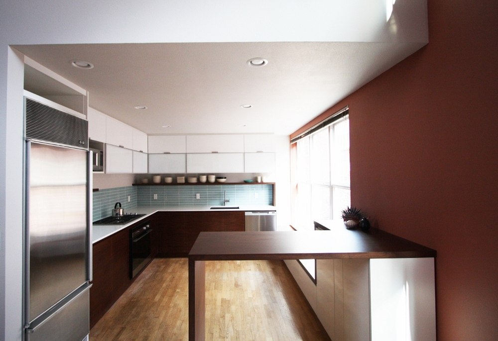 Modern walnut and white custom kitchen cabinets, designed by bright designlab in Portland Oregon.