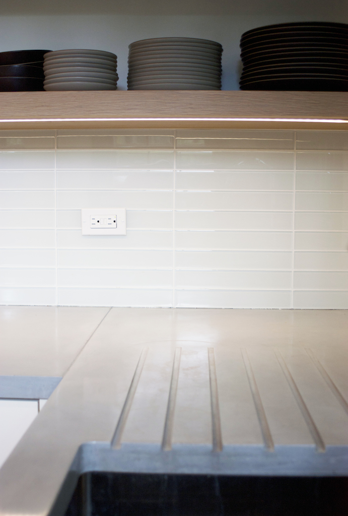 Open shelving and concrete counters