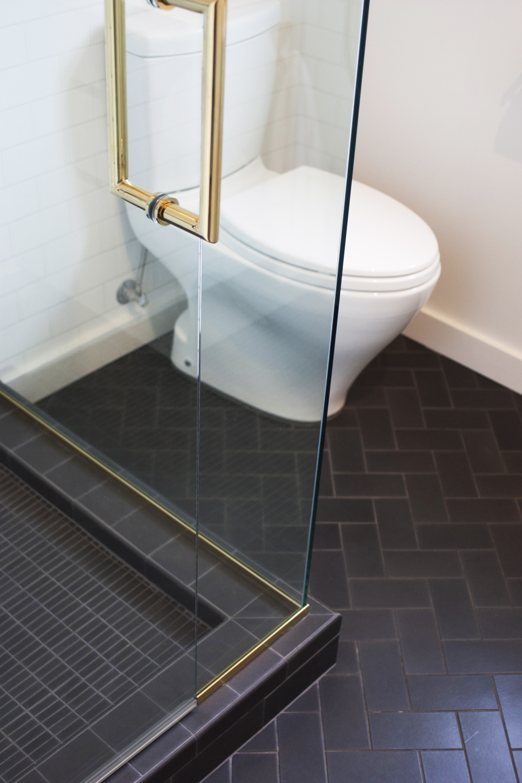 modern bath with brass shower hardware