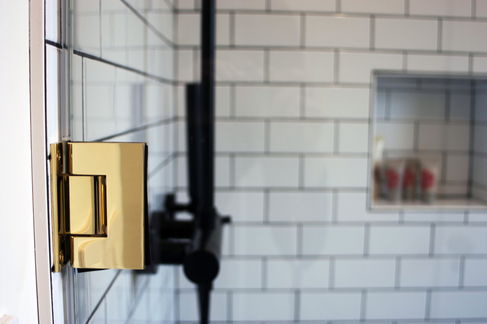 modern Subway tile shower with Brass