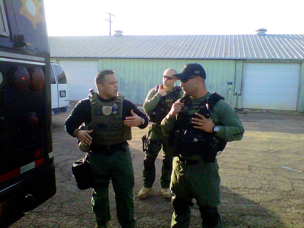 TOG-US, Senior Instructor Lopez instructs operators on how to efficiently deal with tactical concepts when it comes to ICTHR Bus Hostage Rescue.