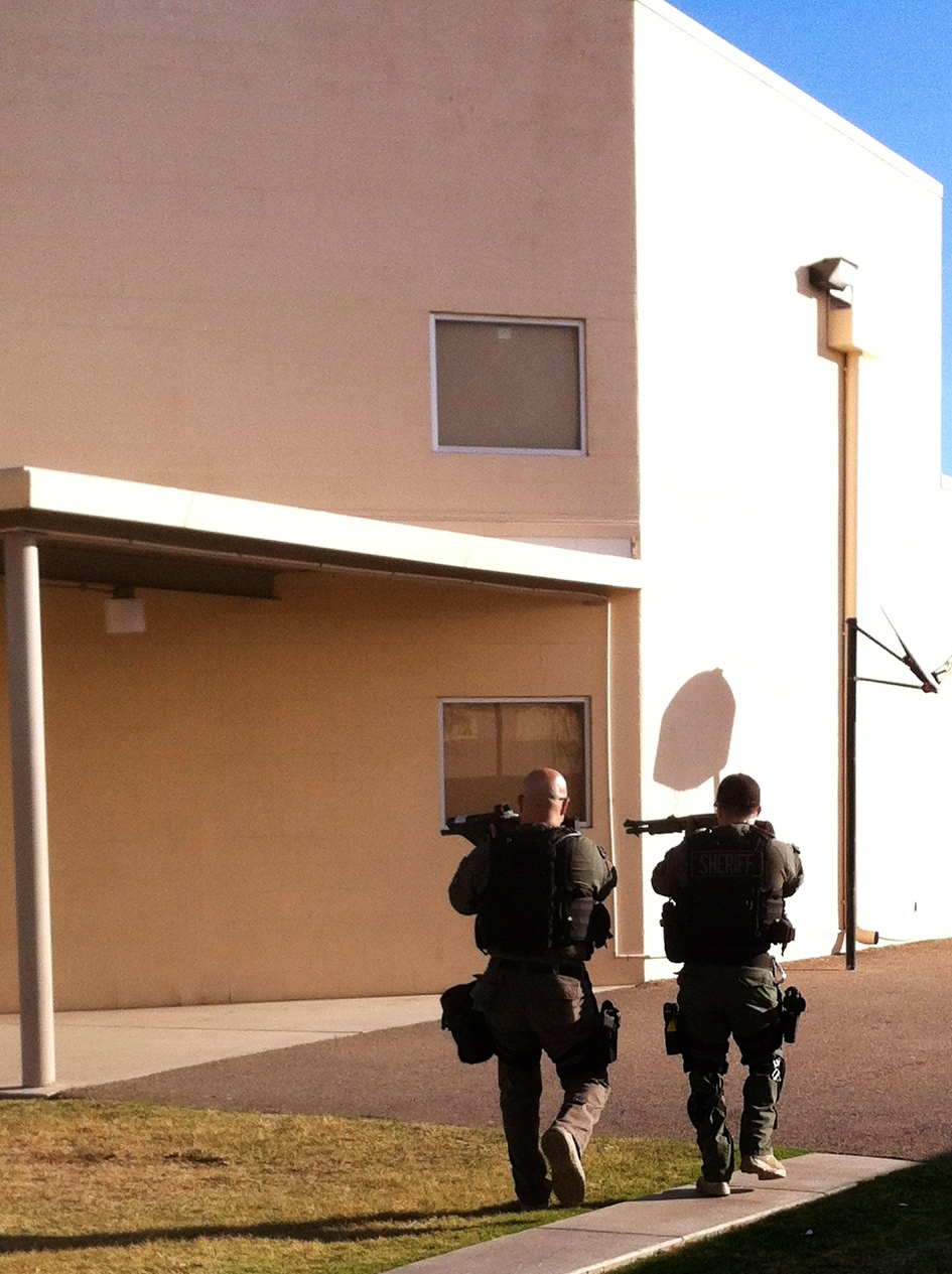 "Operators conduct ""on sight"" threat assessment on possible active shooter/possible hostage situation. One of the many concepts taught at TOG-US. Contact us for more information."