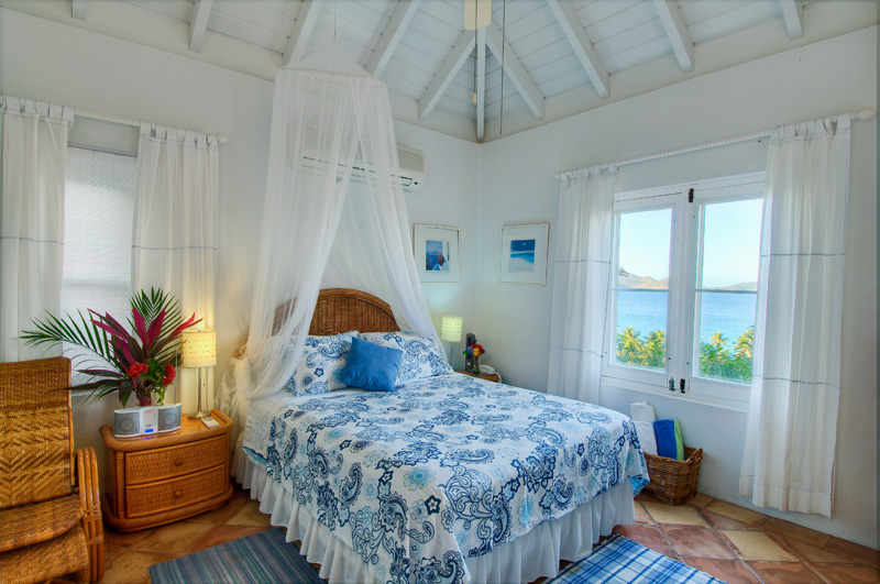 This is the sole bedroom in the guest house of SummerSalt Villa.  It features a queen bed and a private bath.  The guest cottage also has it's own living room with kitchenette, and it's own porch.