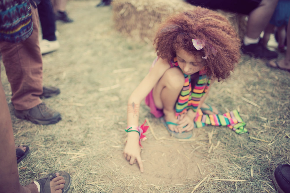 Girl Drawing In the Dirt. Zippy Lomax Photographer.