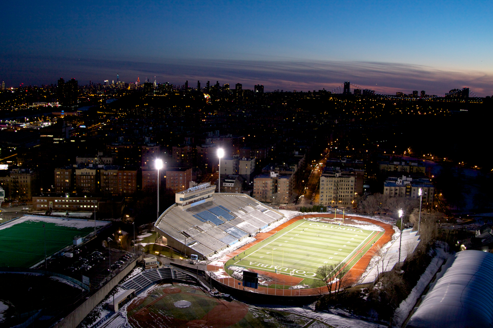 Columbia University's football stadium lit up at dusk. © Bobby Magill