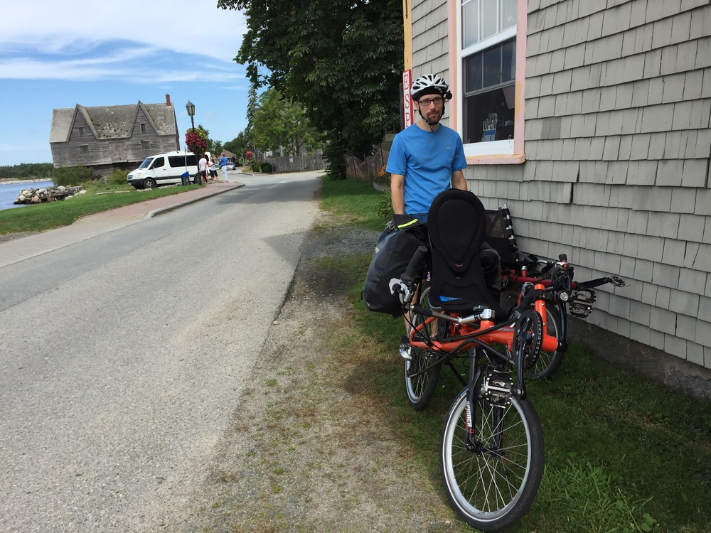 Jacob, parking the bikes for breakfast this morning at a Shelburne cafe. total mileage at this point: 0.8.