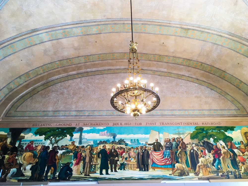 A mural in the Sacramento Amtrak station showing the groundbreaking of the Transcontinental Railroad. © Bobby Magill
