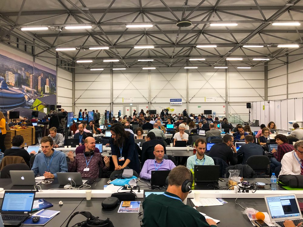 A world of reporters covering COP24. The press area was divided between two floors—this open area on the second floor, and a series of partitioned desks and private cubicles on the first floor, reserved for specific news organizations. ©Bobby Magill