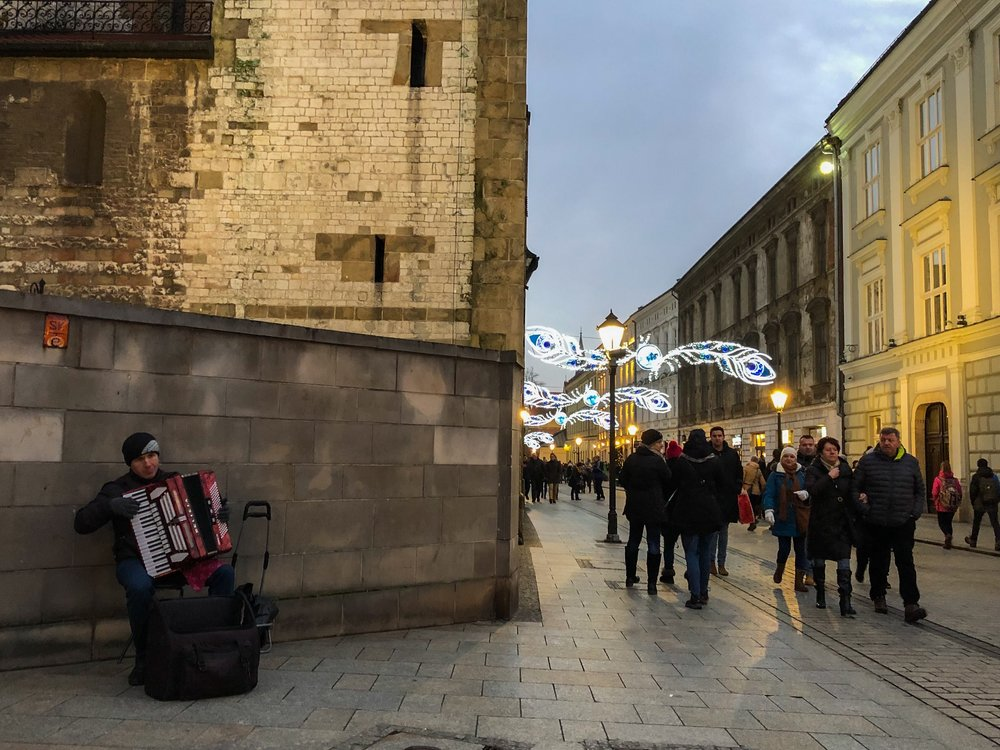 An accordion player in the Stare Miasto district of Krakow—the city's historic core. ©Bobby Magill