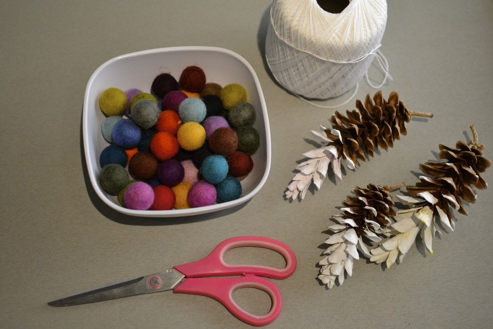 after pine cones have dried, they can be strung up for the garland.
