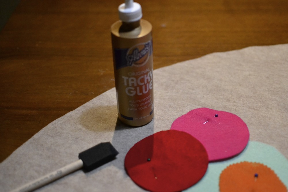 using a foam brush, i lightly applied glue to the edges of my circles and laid them down in place.