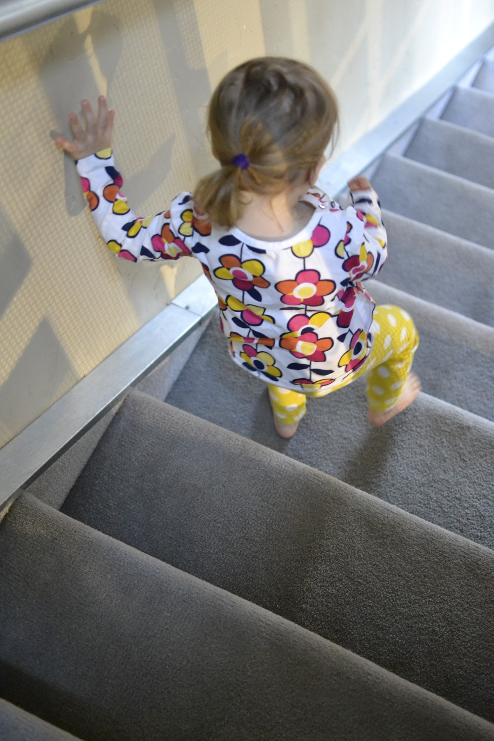 getting so big, she can walk down the stairs on her own.