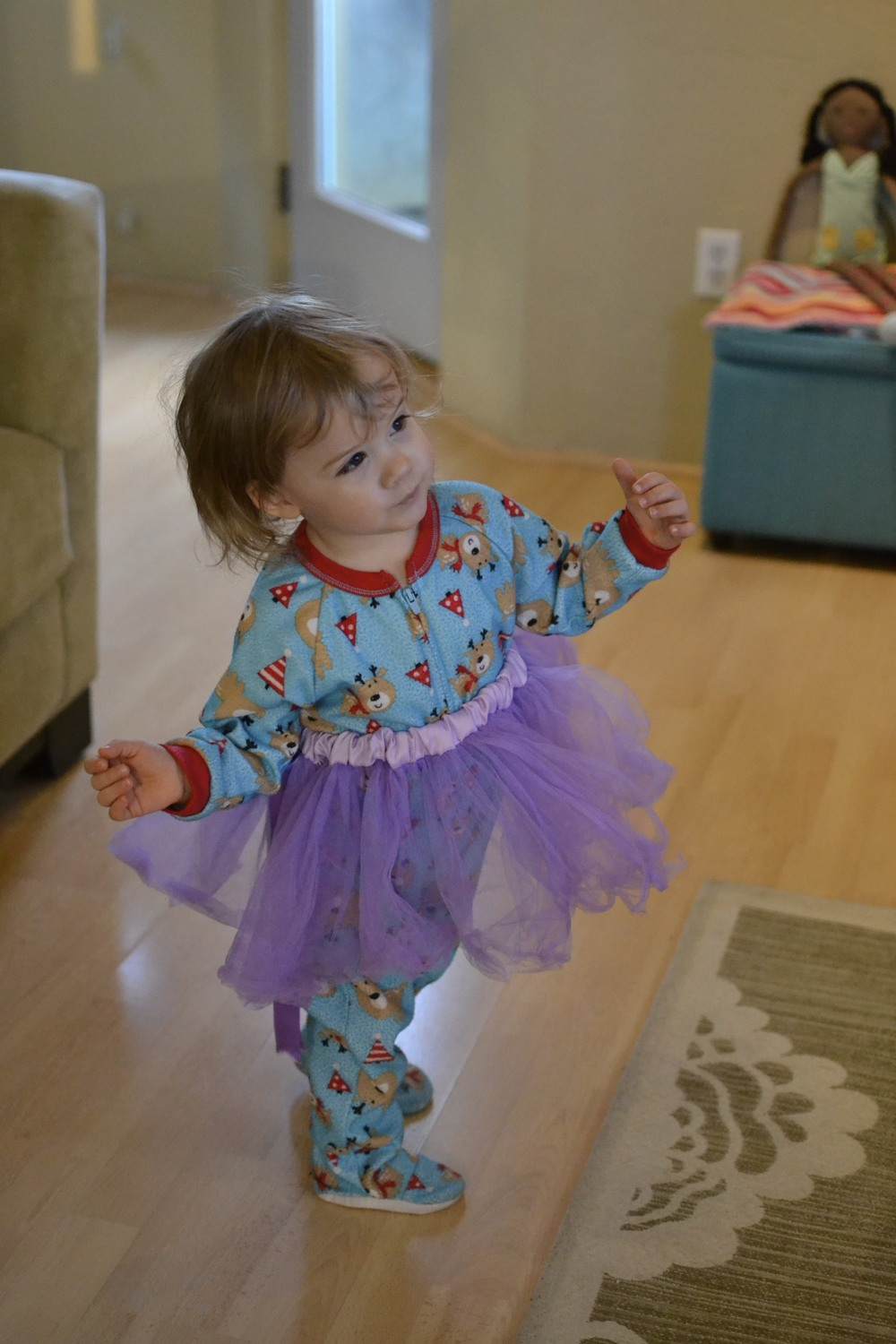 no better way to start the day than with cozy footy pjs and a tutu to dance in.