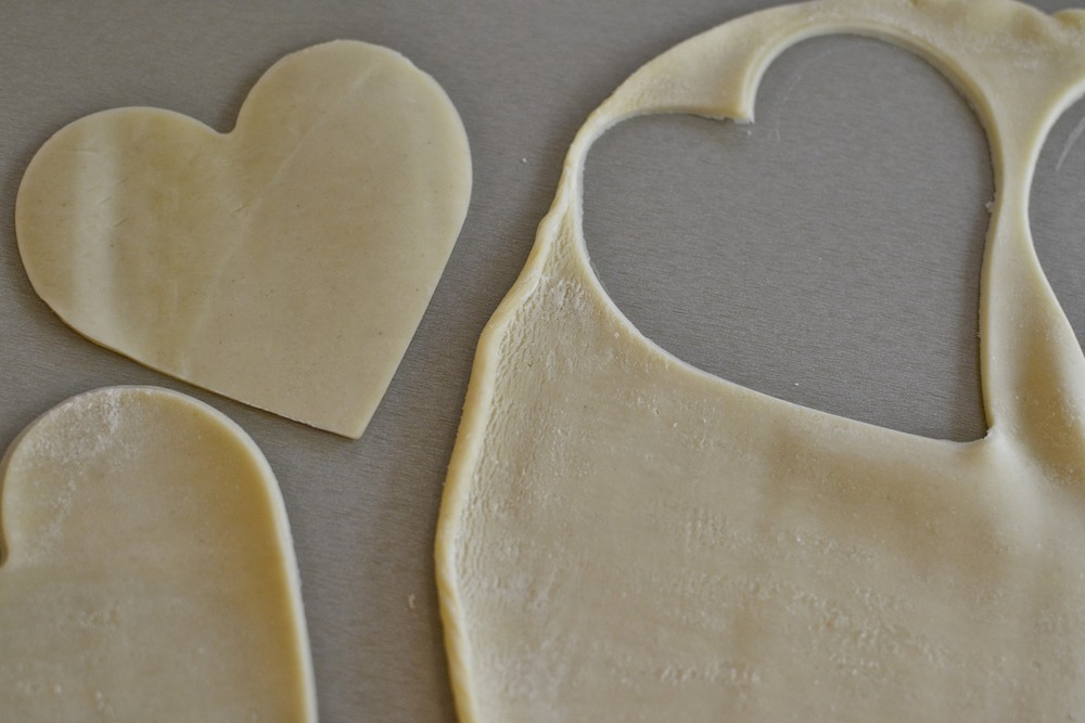 cut out hearts using the back side of the pie mold. you can get 5 hearts out of one pie crust... so 5 pies out of a box of two pre-made crusts.