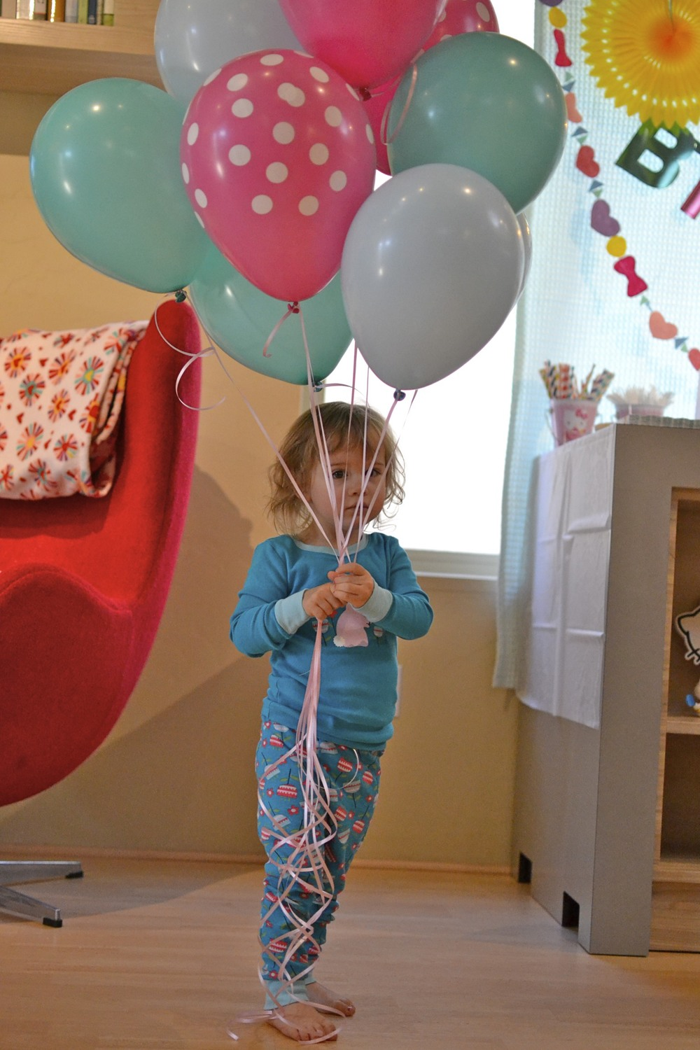 this little bird LOVES balloons and had lots of fun helping me decorate with them before the party