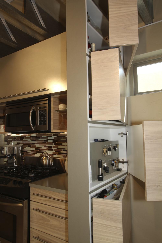 Hidden wall storage cabinets - doors open