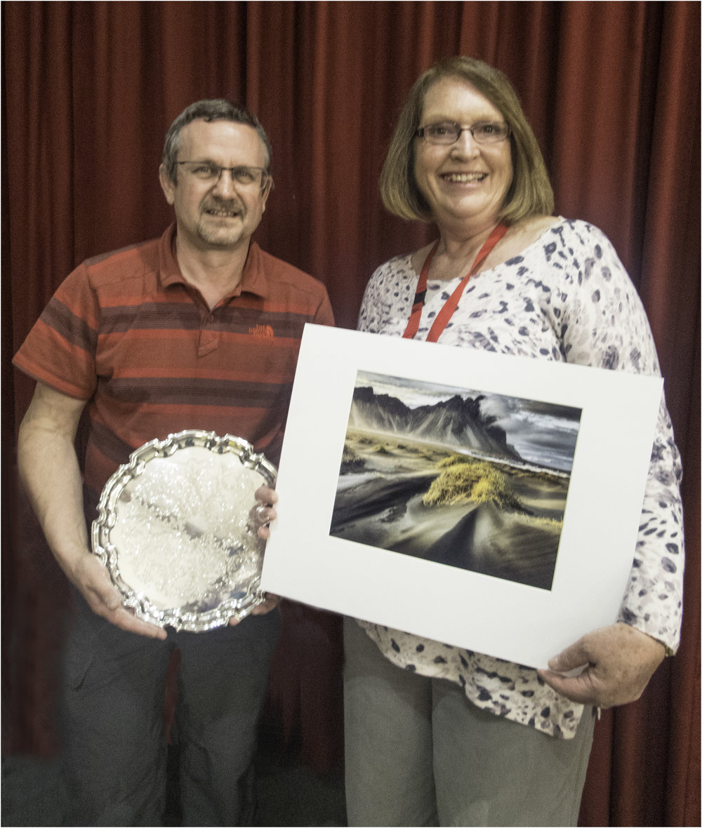Al Haden being presented with his trophy by Chairman Barbara Turner for his winning Print (Advanced Section) 'Stokksness Magic'