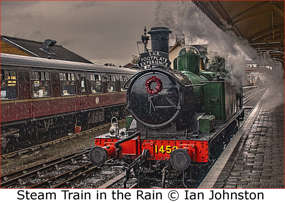 Steam train in rain.jpg