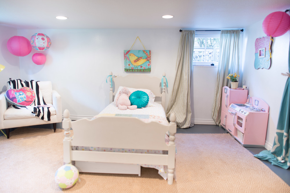A basement bedroom never looked this cute.