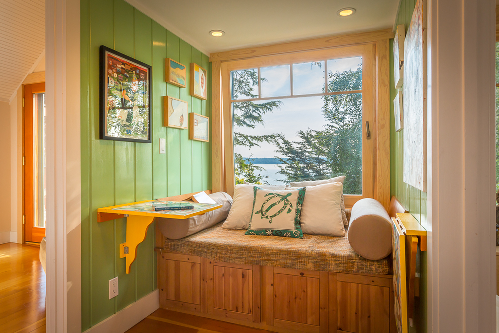 A welcomed space atop the stairs. A reading nook, a work space, a spot to take in the Olympic Mountains and sailboats passing by.