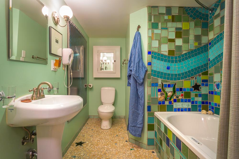 Spa bath with custom mosaic and champagne air jet bathtub.