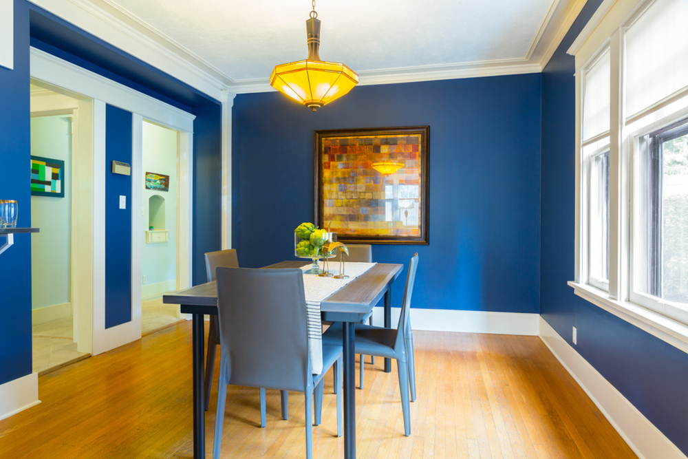 The dining room was red before hitting the market. Changing it to a blue actually transformed the entire space and feel.