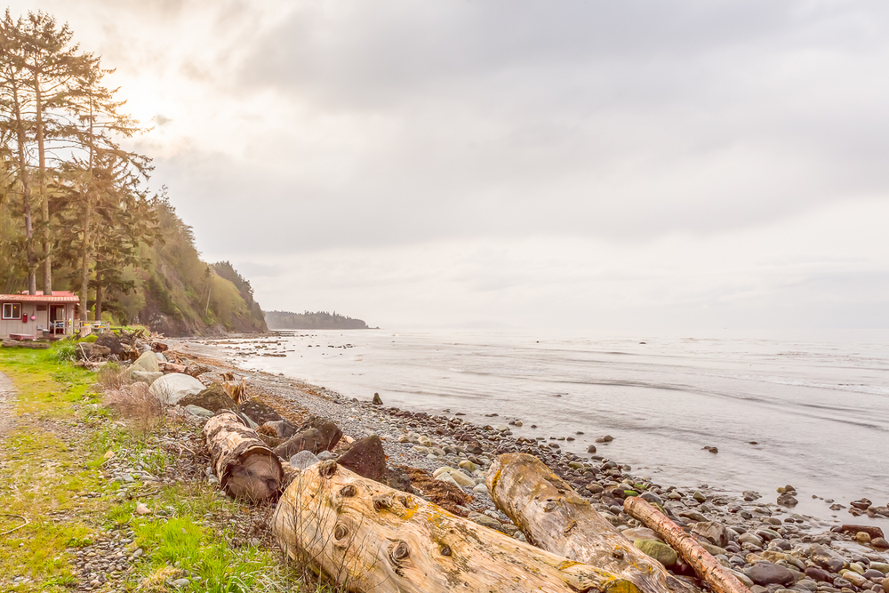 North facing on the Strait of Juan de Fuca, more than 1500 linear feet of beach front.