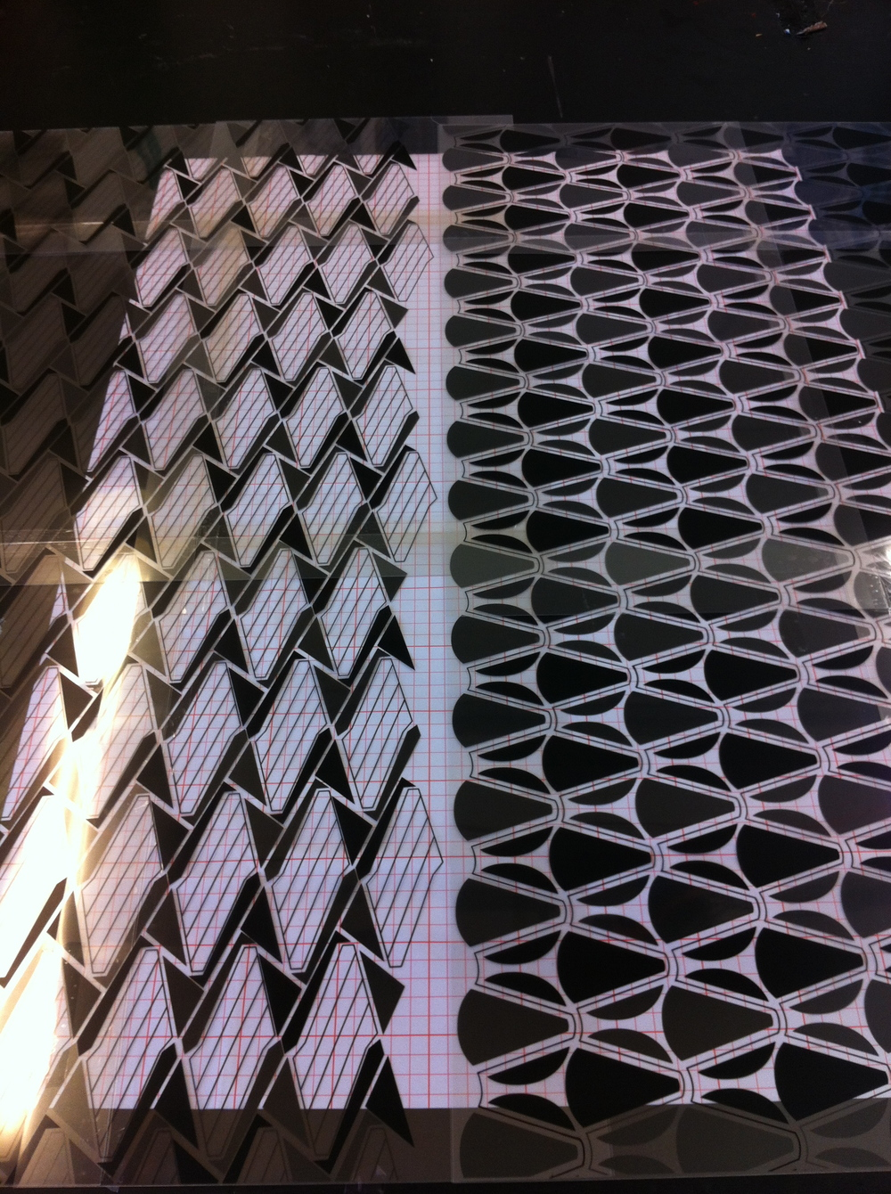 Colour separations printed onto acetates in preperation for exposing onto the screens. Screens are coated with a light sensitive emulsion and once dry are placed in a UV exposure until with the acetates underneath. The light fixes the emulsion to the screen, except where the black of the acetates block it out.