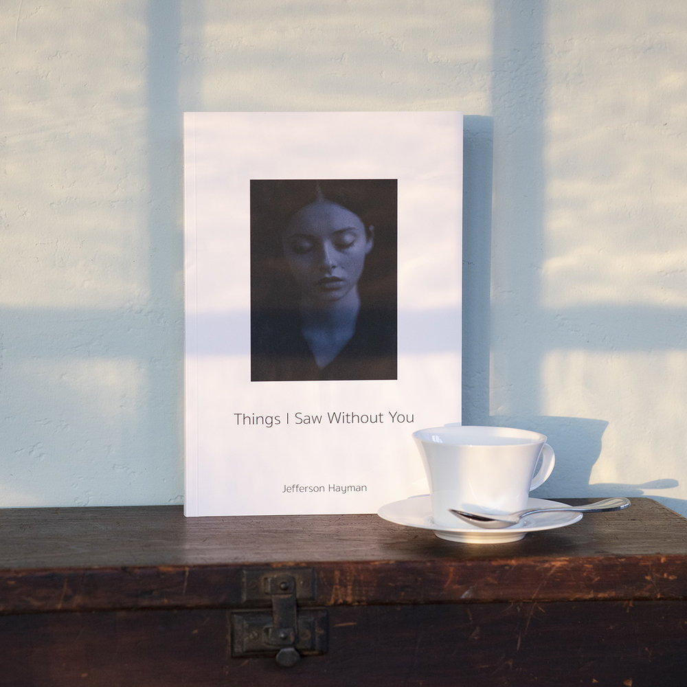 Jefferson Hayman  Things I Saw Without You   Edition One (April 2018) Foreword by Kat Kiernan   Things I Saw Without You  is the third monograph by photographer Jefferson Hayman. Influenced by the medium's pioneers, Jefferson Hayman's photographs have a stillness that allows us to linger over the tableau. Delicate and quiet, his photographs speak to us in hushed tones. The muted palates and minimal compositions provide a moment of pause in an otherwise frenetic world.