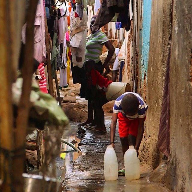 #boy gathering #water in #mathare #slum #kenya #nairobi #africa #helpthoseinneed #love #cleanwater #school #giving #iwillreturn
