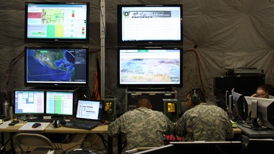 The Command Post of the Future's typical setup: lots of connected visualizations spread out across lots of screens.