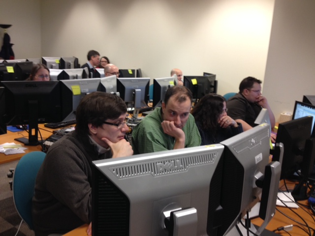 Developers using the DASH front-end during an internal collaboration exercise.  The design team coordinated several collabexes to let developers test out the system in an operational scenario before fielding.