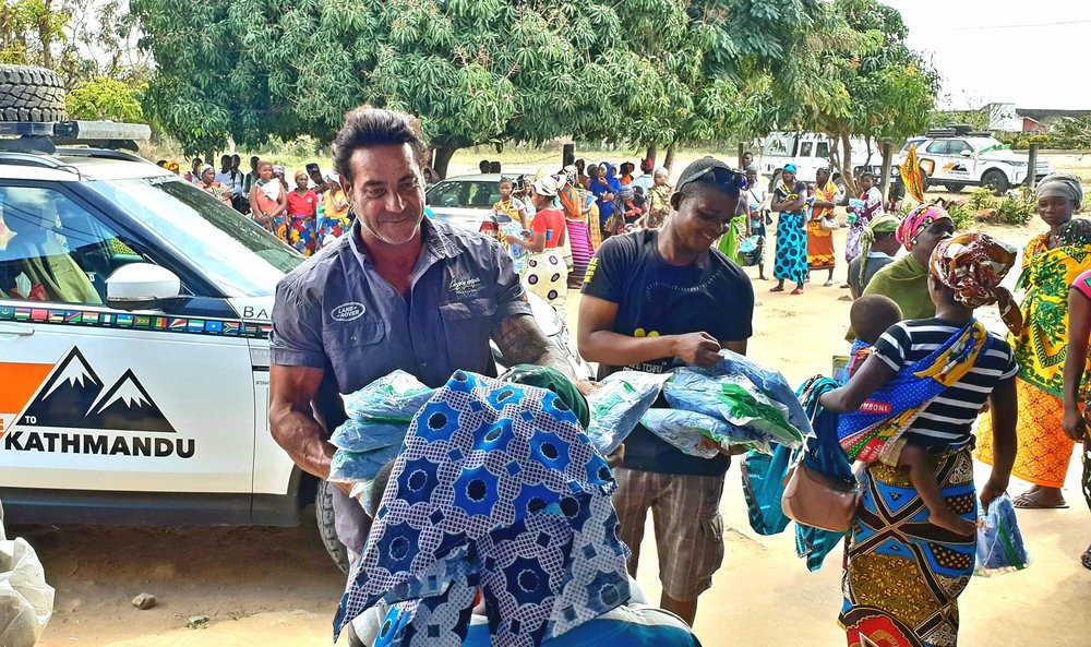 Ross Holgate and Babu Cossa (Mozambiquan malaria education team member) distribute bed-nets to mothers and pregnant women at high risk of malaria at the Carapira maternity clinic, Mozambique 20180820_170951.jpg