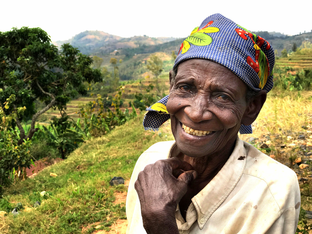 Mariyane, 86 years old, still farms the rice fields daily. A mother to six kids, she lost her husband and three kids in the genocide in 1994, but today has a huge family with many great great grandkids. She's full of joy and leads her family with inspiring pride.