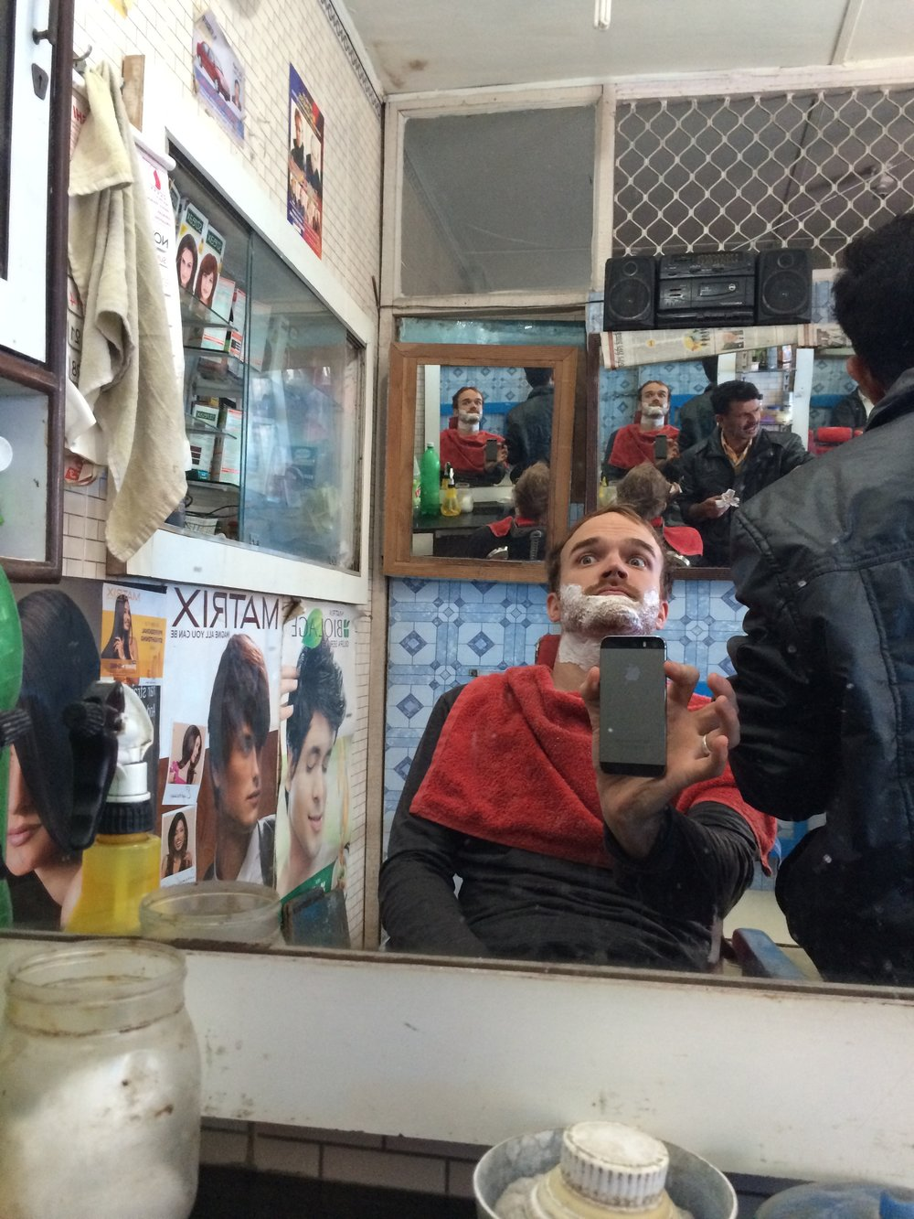 Slightly spooked while getting a shave with the locals in northern India. Shot on iPhone 5S.