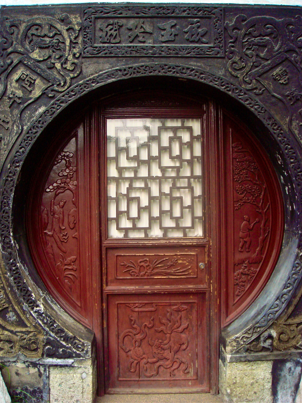 Ornate Door into a Walled Garden             Shanghai, China