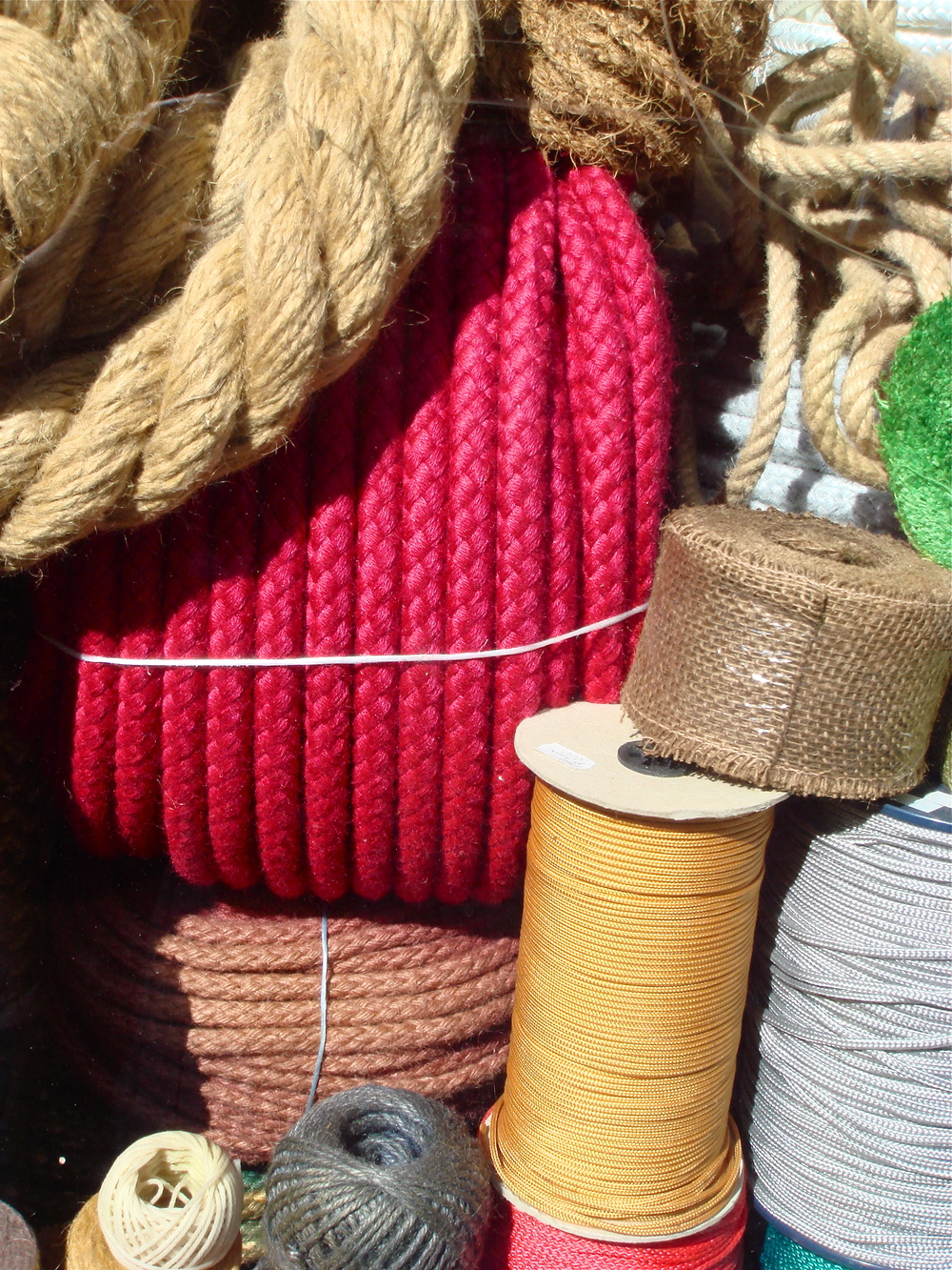 A collection of colourful ropes and twine at a street market in Prague