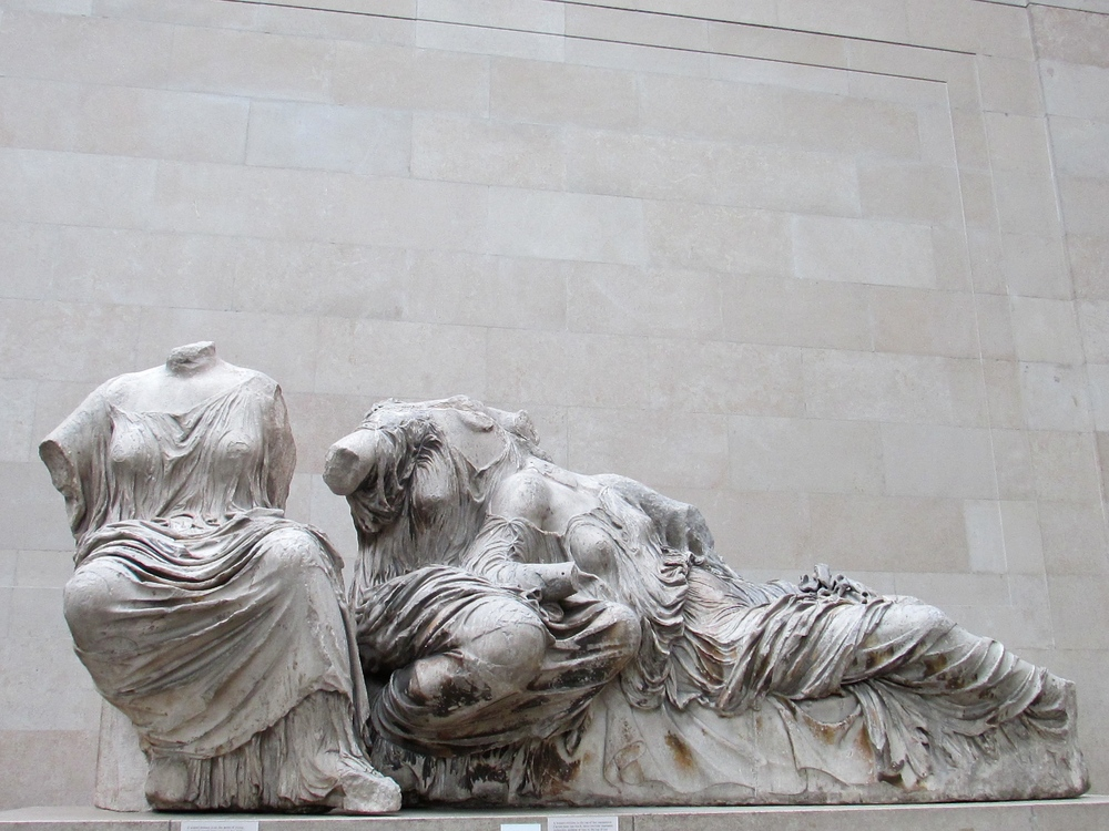 The female form is expertly rendered in the marble under the folds of fabric. It's hard to believe that it is cold marble and not actual clothing that covers the headless figures.