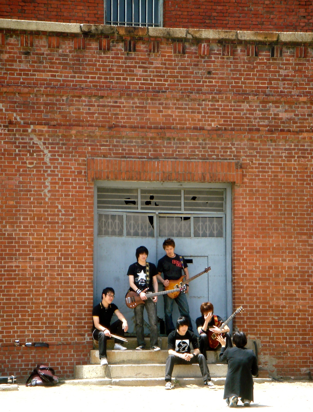 A boy band shooting their album cover at Seodaemun Prison in Seoul, South Korea