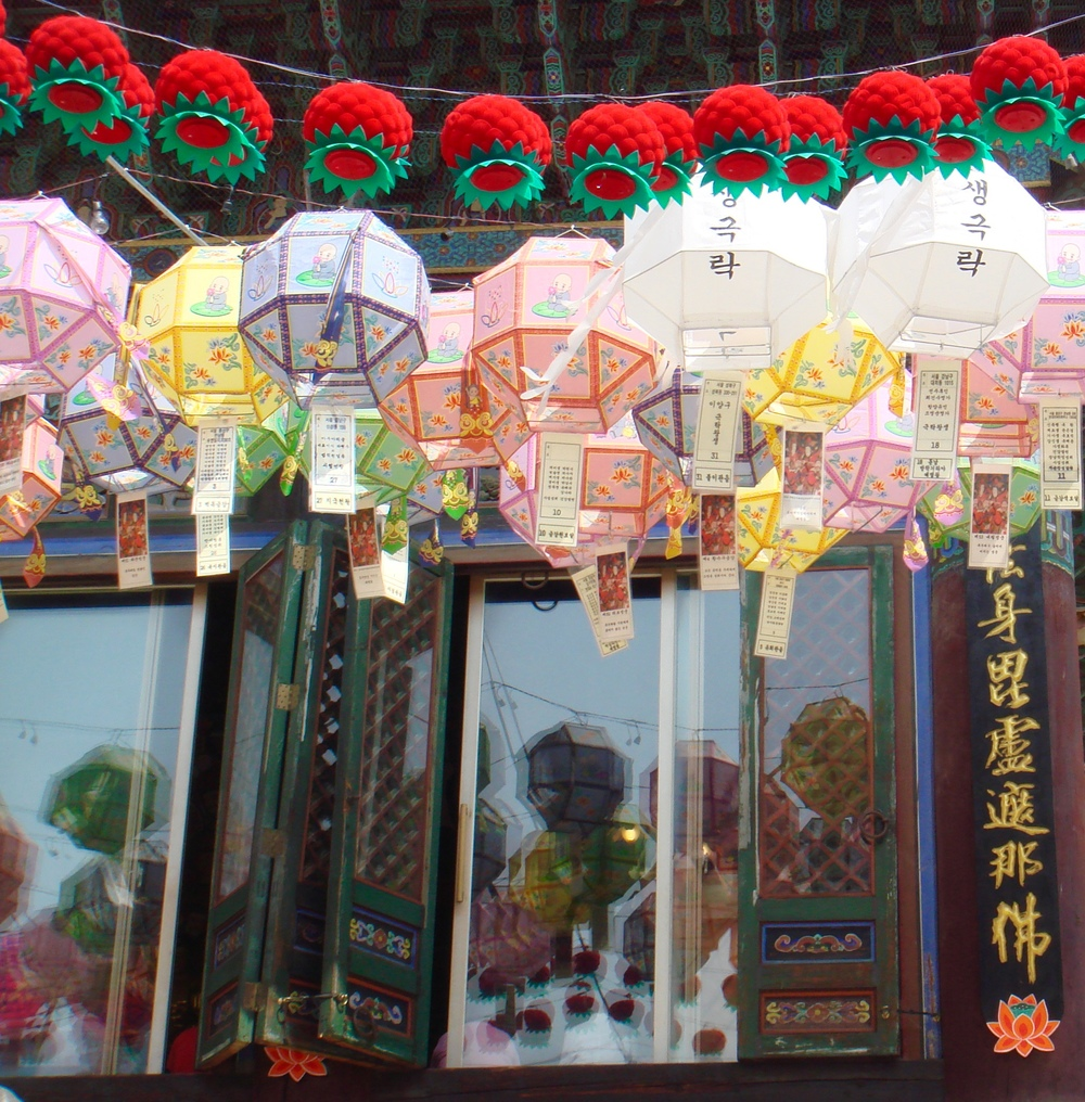 Lanterns hanging at Bongeunsa Temple in Seoul, South Korea during Buddha's Birthday celebrations. The paper hanging from the bottom of the lanterns are prayers and wishes for the coming years.