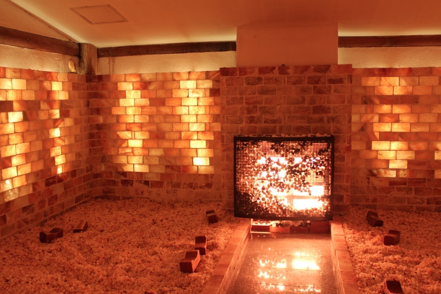 The interior of a communal salt sauna. You are supposed to sit in the salt and cover yourself in it to absorb it's purifying characteristics. (image source)