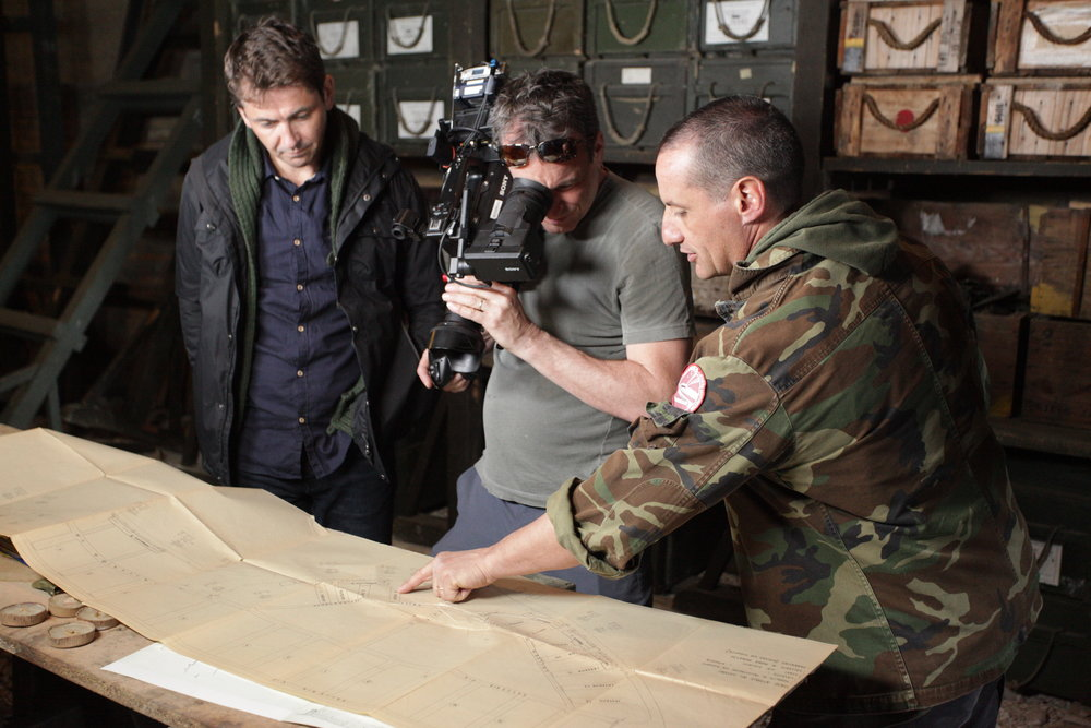 Conor Woodman and Cameraman Mark Caswell examine diagram of an underground bunker in Italy where Nazi gold could be hidden.JPG