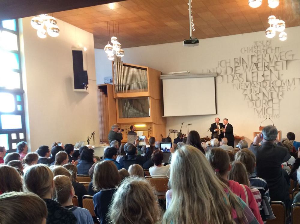 The Last Sunday in the Old Building. If you look closely, you can see the minister, Waldemar, handing over the keys to the Korean pastor. Well, the giant symbolic key, that is!