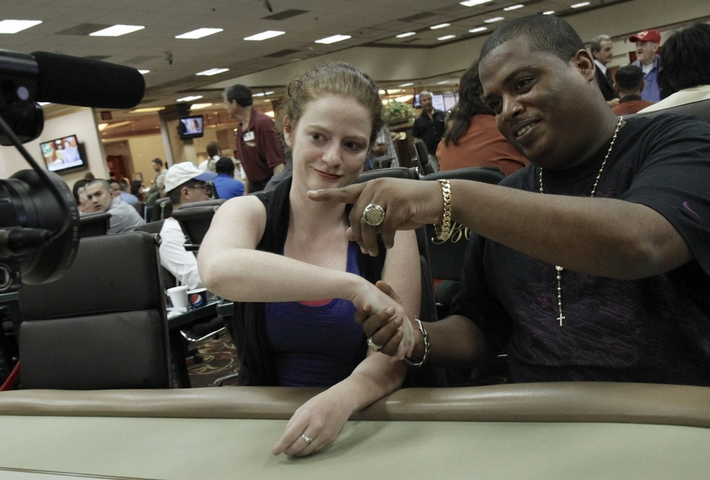 Photo: Jessica interviews Dwyte Pilgrim during a break in a WPT event.