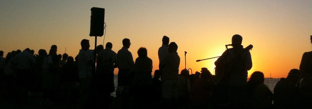 Photo:  Watching sunset from Mallory Square in Key West, Florida in November, 2009.