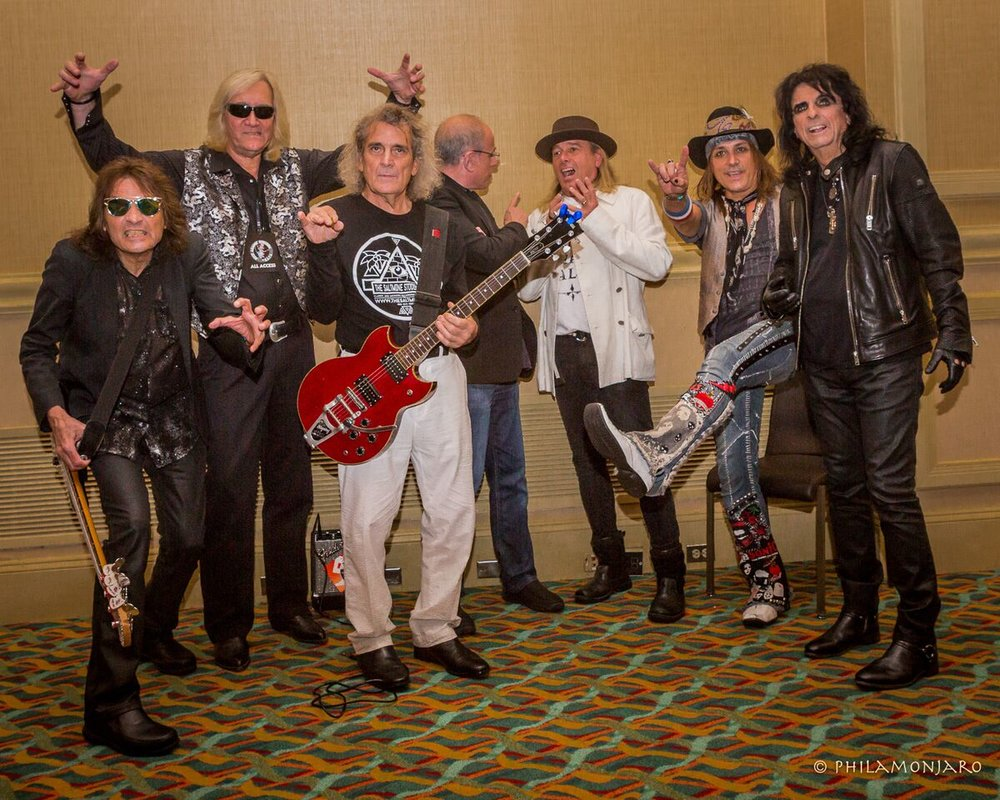 Backstage after the show at Music Biz 2017. Left to right: Dennis Dunaway, Neal Smith, Michael Bruce, Bob Ezrin, Robin Zander, Ryan Roxie, and Alice Cooper. Photo by Philamonjaro.