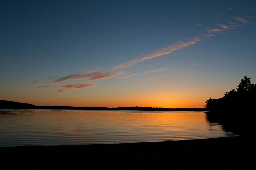 THE SUN SETS OVER KEJIMKUJIK LAKE IN NOVA SCOTIA. THE SUN WILL CROSS THE CELESTIAL EQUATOR INTO THE NORTHERN HEMISPHERE ON MARCH 20 AT 1:30 A.M., MARKING THE BEGINNING OF SPRING. (JOHN MCPHEE)