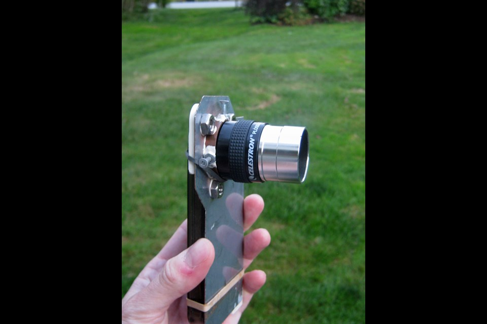 Art Cole designed a bracket that attaches his iPhone to his telescope, which keeps the phone camera steady taking video of the planets and the moon. (ART COLE)