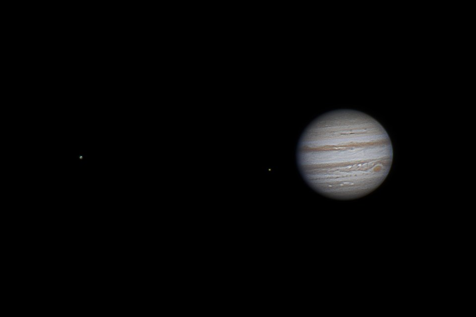 Jupiter and a couple of its moons are seen in February 2014. (ART COLE)